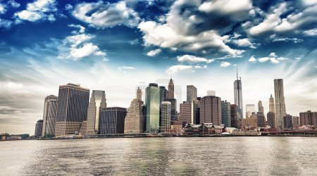 Photo for Panoramic view of Lower Manhattan skyline from Brooklyn Bridge Park on a sunny day - New York City. - Royalty Free Image