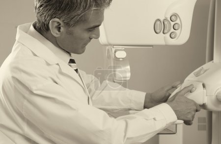 Doctor  with mammography machine