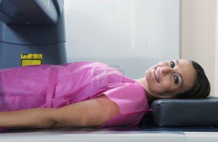 Woman  undergoing a bone densitomer scan