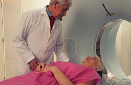 Senior doctor examining woman