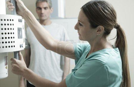 Doctor checking x-ray machine