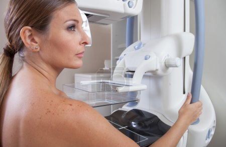 Woman with mammography scan