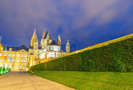 Caen. Normandy. Men Abbey exterior and gardens at night