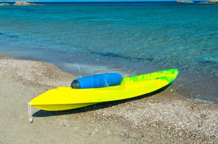 Beautiful yellow canoe on the beach
