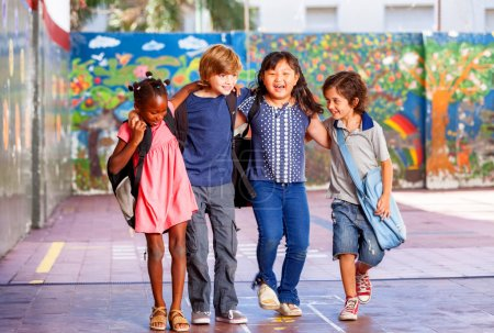 Schoolchildren embracing happy. Multi cultural racial classroom