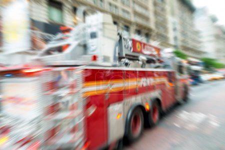 Blurred fast moving firefighters truck in New York City