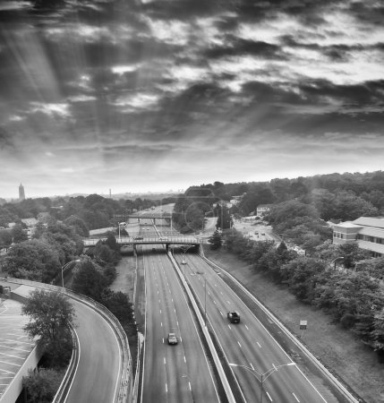 Photo for Traffic on interstate highway under dramatic sky in USA. black and white - Royalty Free Image