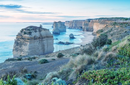 Twelve Apostles rocks in Australia at sunset along Great Ocean Road, Victoria -