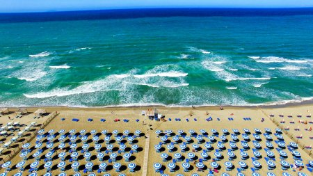Beautiful aerial view of beach chairs and umbrellas along the oc