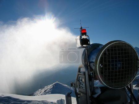 Snow-gun working on a ski slope