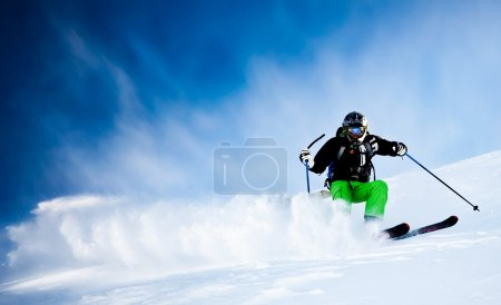 Man's skiing in fresh snow