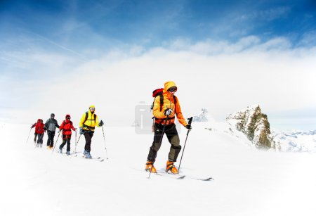 Group of alpine touring skiers on the big Verra Gl...