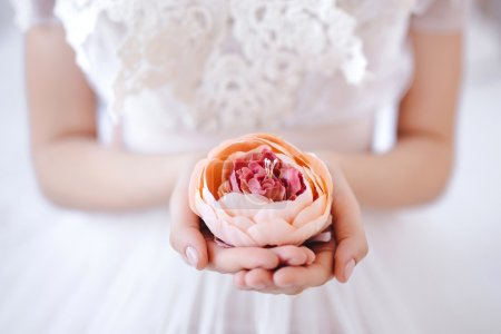 flower in the hands of the bride
