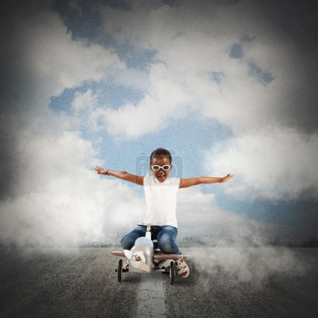 Photo for Playful little girl on an airplane with wheels - Royalty Free Image