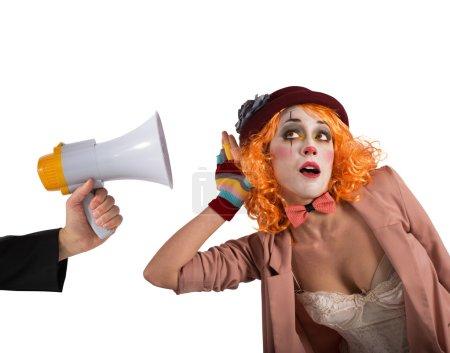 Clown hears a megaphone