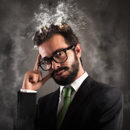 Stressed businessman with his head in smoke