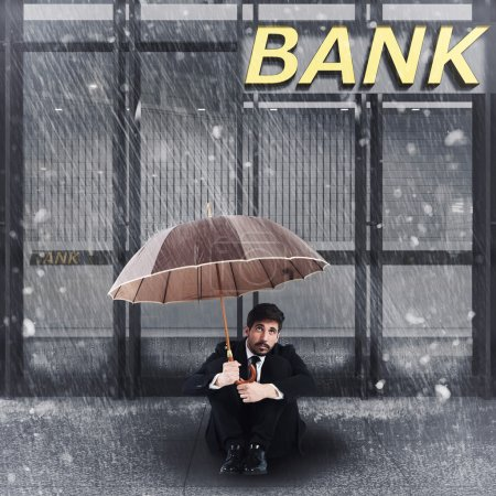businessman sitting in front of a bank