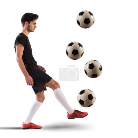 Teenage soccer player with soccer balls