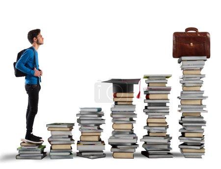 Photo pour Garçon monter les escaliers en livres sur fond blanc - image libre de droit