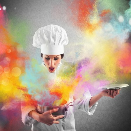 Woman chef with colors from a pot