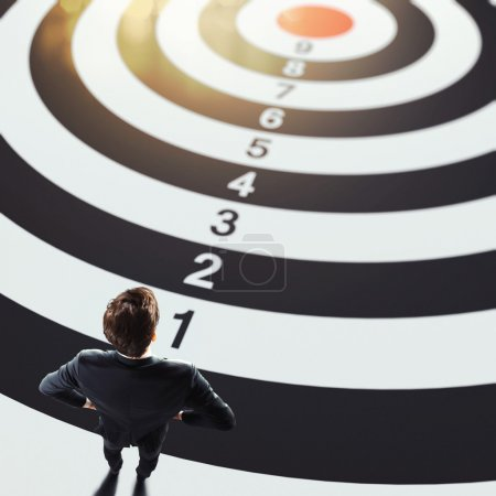 Man on a big target with numbers