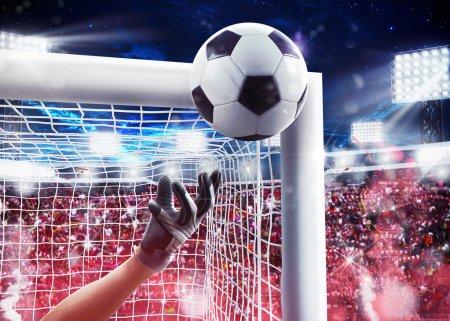 Photo pour Gardien de but sauvant le ballon avec les fans d'arrière-plan dans le stade. Rendu 3D - image libre de droit