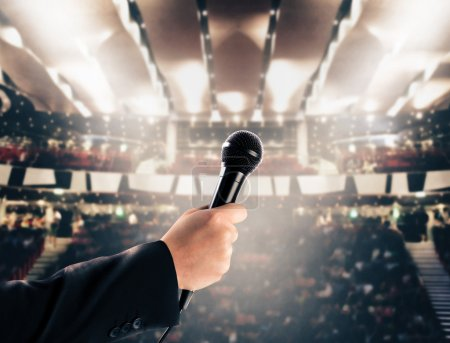 hand with microphone in a theater