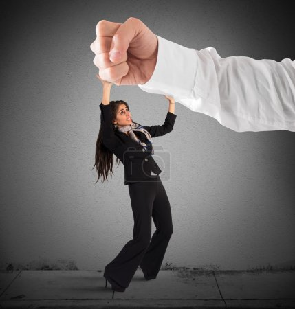 Photo for Big punch striking a frightened small woman - Royalty Free Image