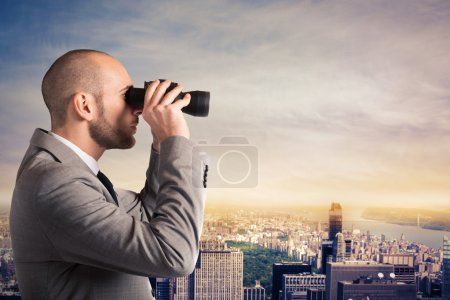 Businessman looking at the city landscape
