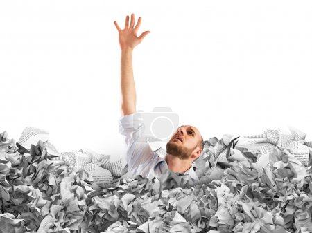 businessman drowning between worksheets