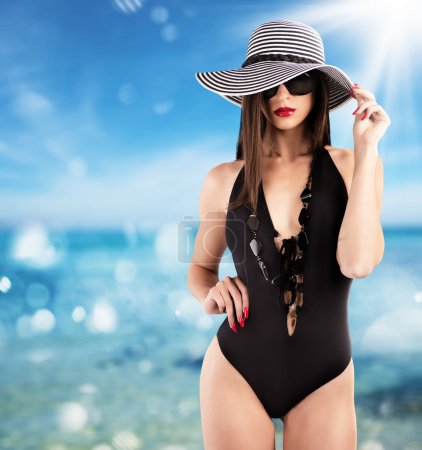 Charming woman wearing elegant swimsuit