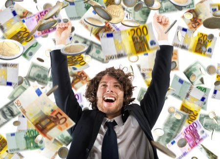 businessman   under a rain of coins