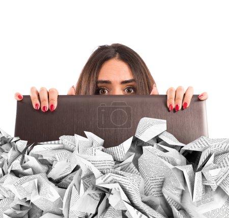 Businesswoman hidden behind the laptop