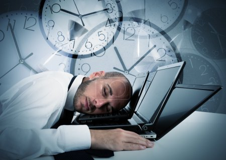 Businessman sleeping on laptop and background with...