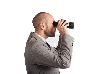 man looking carefully through binoculars