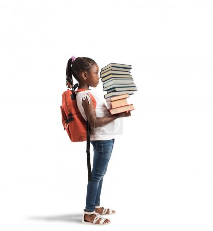 Photo for Child with backpack and  books pile - Royalty Free Image