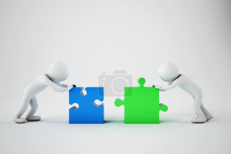 businesspeople building  a company with puzzle.