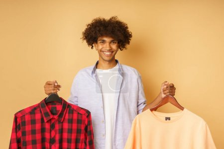 Photo for Happy afro happy man buy clothes on a store - Royalty Free Image