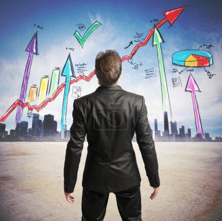 Businessman watchs successful statistics