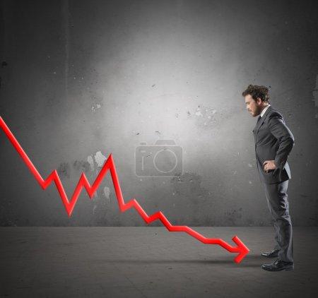 Businessman with negative statistics