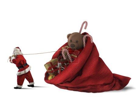 Photo pour Santa Claus pulls a big sack of presents on white background - image libre de droit