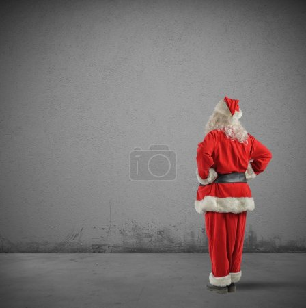 Photo for Santa Claus's back on texture wall background - Royalty Free Image