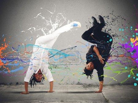Brazilian men dancing capoeira