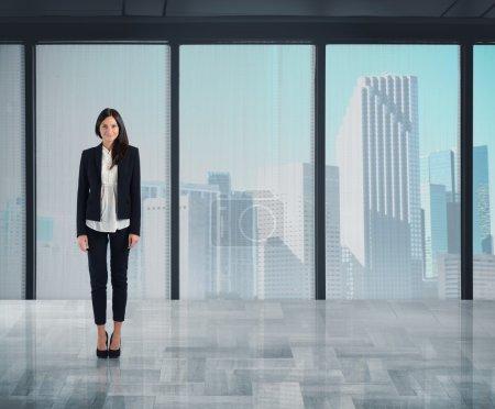Businesswoman working in skyscraper office