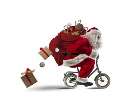 Photo for Santaclaus delivering gifts with a small bicycle - Royalty Free Image