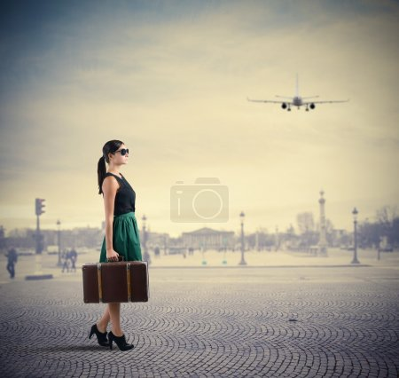 Woman classy traveller walks in a square