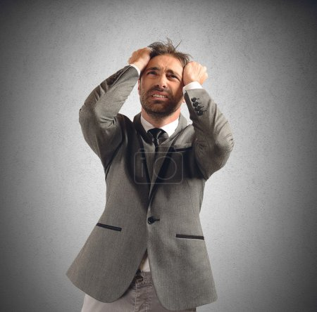 Photo for Businessman stressed and desperate for his problems - Royalty Free Image