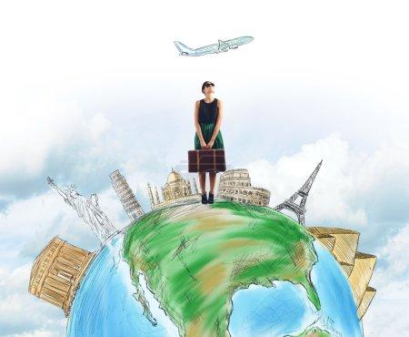 Woman tourist chooses her destination