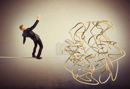 Businessman attempts to get to tangle