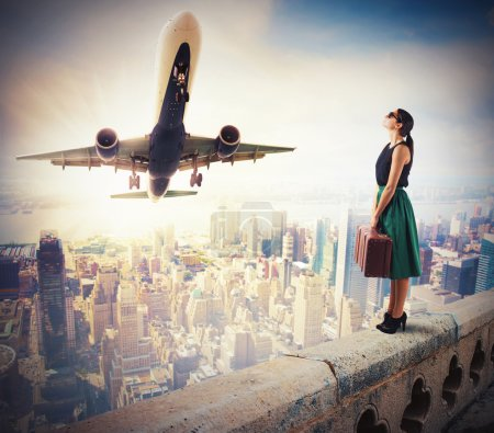 Photo for Woman tourists watch the takeoff of a aircraft - Royalty Free Image